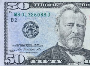 Portrait of US president Ulysses Simpson Grant on 50 dollars banknote closeup macro fragment. United states fifty dollars money bill close up